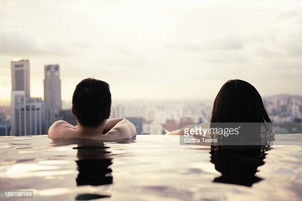 Swimmers overlooking city skyline