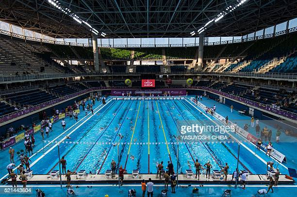 Swimmers practice during the Maria Lenk Trophy 2016 test event for the Rio 2016 Olympic games at the Olympic Aquatics Stadium at the Olympic Park in...