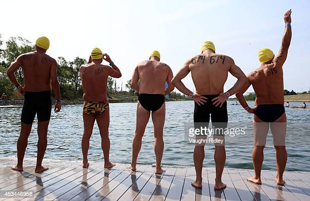 Swimmers prepare for the Men's 4549 Age Group 3km swim during the 15th FINA World Masters Championships at Parc JeanDrapeau on August 10 2014 in...