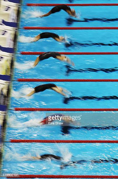 Swimmers push off the block for the start of heat four of the Women's 50m Backstroke heats during Day Twelve of the 14th FINA World Championships at...