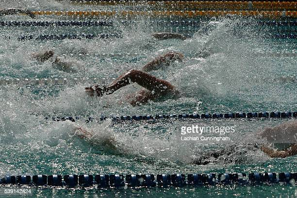 Swimmers race in the heats of the 50m freestyle during day two of the 2016 Arena Pro Swim Series at George F Haines International Swim Center on June...