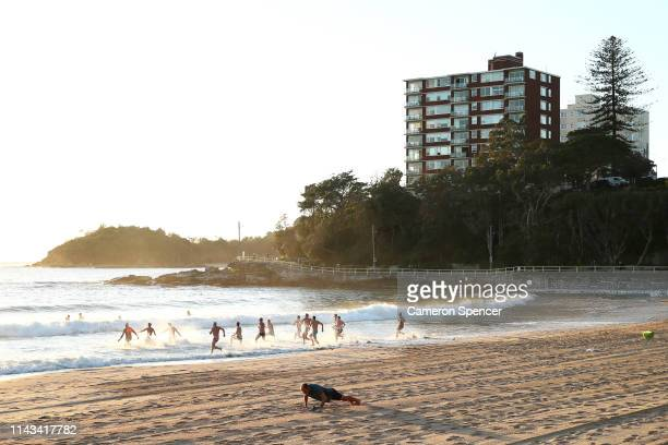 Swimmers race into the ocean at Manly Beach in the electorate of Warringah on April 18 2019 in Sydney Australia The electorate of Warringah is...