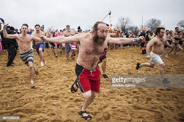 Swimmers sprint down the beach to be some of the first in the water at the 19th Annual Maryland State Police Polar Bear Plunge at Sandy Point State...