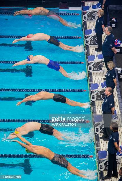 Swimmers start the Men's 200m Backstroke during the International Swimming League Championship Finale at the Mandalay Bay Hotel in Las Vegas, Nevada...