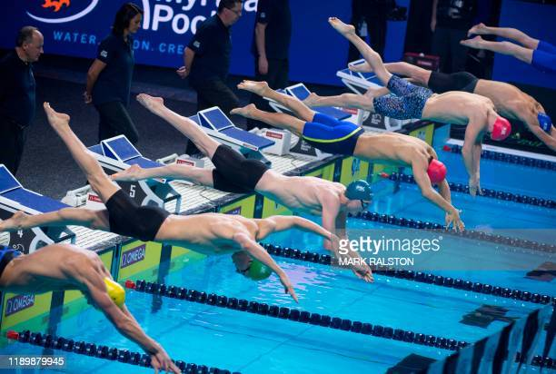 Swimmers start the Men's 200m Individual Medley race during the International Swimming League Championship Finale at the Mandalay Bay Hotel in Las...