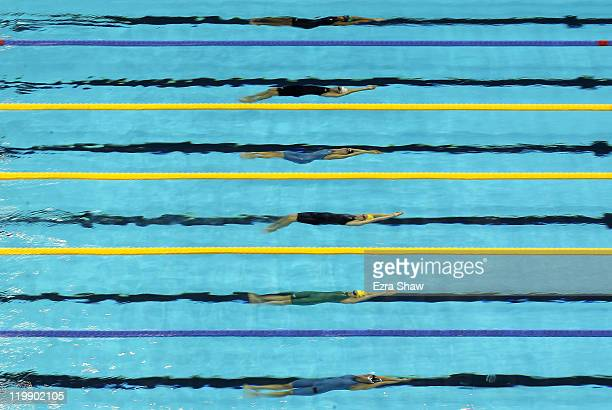 Swimmers swim underwater at the start of heat seven of the Women's 50m Backstroke heats during Day Twelve of the 14th FINA World Championships at the...