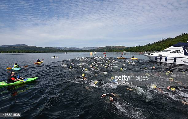 Swimmers take part in a 5km swim in Lake Windermere in Cumbria, north west England, on June 12 on the first day of the Great North Swim. The Great...