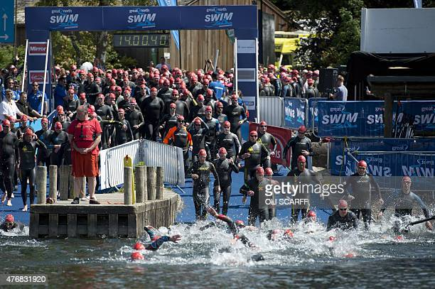 Swimmers take part in a 5km swim in Lake Windermere in Cumbria north west England on June 12 on the first day of the Great North Swim The Great North...
