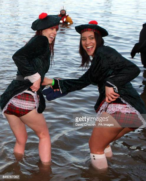 Swimmers take part in the Loony Dook New YearOtildes Day swim in the river Forth near the Forth Rail Bridge