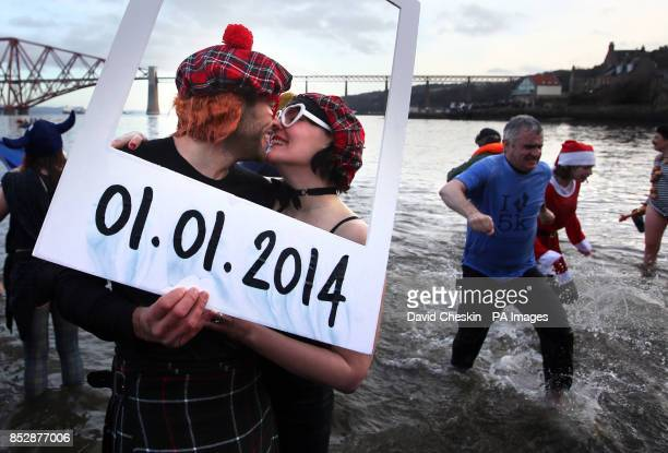 Swimmers take part in the loony dook New Year's Day dip in the Firth of Forth at South Queensferry as part of Edinburgh's threedaylong Hogmanay...