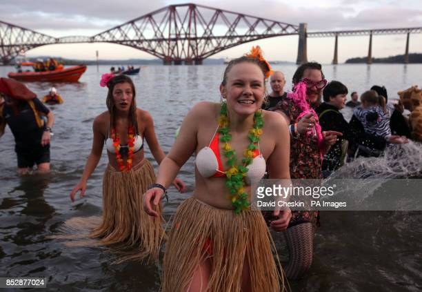 Swimmers take part in the 'loony dook' New Year's Day dip in the Firth of Forth at South Queensferry as part of Edinburgh's threedaylong Hogmanay...