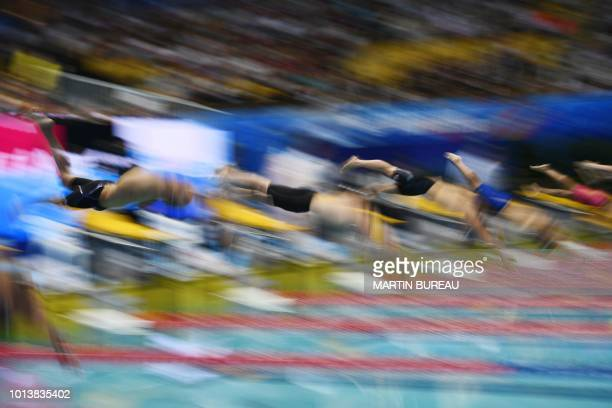 TOPSHOT Swimmers take the start of the 1500m men freestyle event of the Pan Pacific Swimming Championships 2018 in Tokyo on August 9 2018
