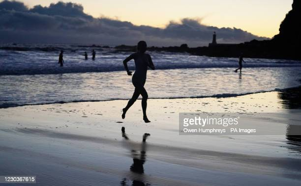Swimmers take to the freezing North Sea at King Edwards Bay near Tynemouth on New Years Eve