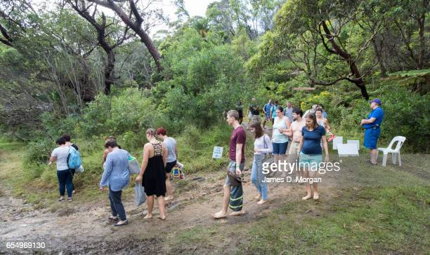 Swimmers walk donw to the beach before the 'Sydney Skinny' on March 19 2017 in Sydney Australia The annual nude swim event encourages swimmers to...