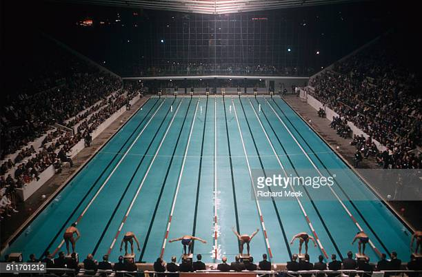 1956 Summer Olympics Overall view of swimmers on block before Men's race at Olympic Park Swimming and Diving Stadium Melbourne Australia CREDIT...