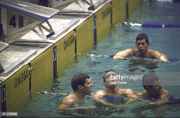 Swimming 1968 Summer Olympics AUS Michael Wenden victorious in water after winning 200M freestyle race vs USA Donald Schollander and USA John Nelson...