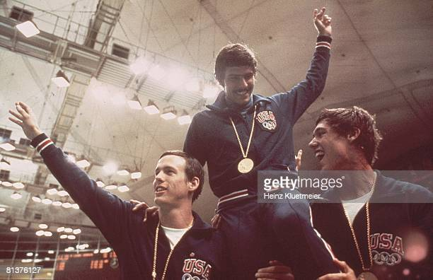 Swimming 1972 Summer Olympics USA Mark Spitz victorious getting carried off field by teammates after winning gold medal in relay event Munich FRG...