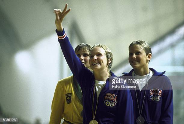 1972 Summer Olympics USA Sandra Nelson victorious with gold medal on medal stand with USA Shirley Babashoff and Australia Shane Gould after winning...