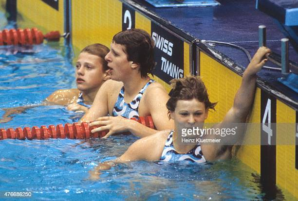 1976 Summer Olympics East Germany Antje Stille Birgit Treiber and Ulrike Richter in pool after Women's 100M Backstroke Final at Montreal Olympic Pool...