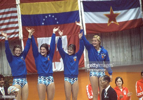 1976 Summer Olympics East Germany Ulrike Richter Hannelore Anke Andrea Pollack and Kornelia Ender victorious on medal stand after winning Gold during...