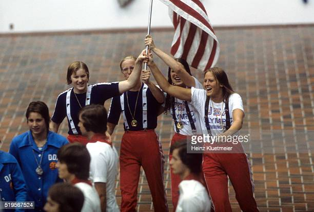 1976 Summer Olympics USA Jill Sterkel Wendy Boglioli Kim Peyton and Shirley Babashoff victorious with national flag after winning gold during Women's...