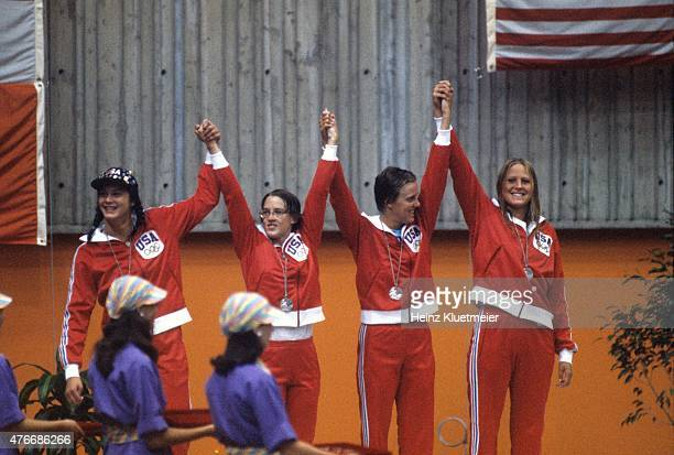 1976 Summer Olympics USA Linda Jezek Lauri Siering Camille Wright and Shirley Babashoff victorious on medal stand after winning Silver during Women's...