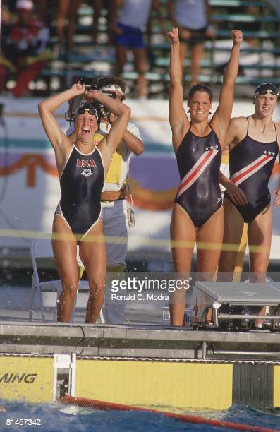 Swimming 1984 Summer Olympics USA Team Carrie Steinseifer Dara Torres and Jenna Johnson cheering on teammate Nancy Hogshead during last leg of 4x100M...