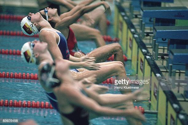 1988 Summer Olympics East Germany Kristin Otto in action from blocks during start of Women's 100M Backstroke Final at Chamshil Indoor Swimming Pool...