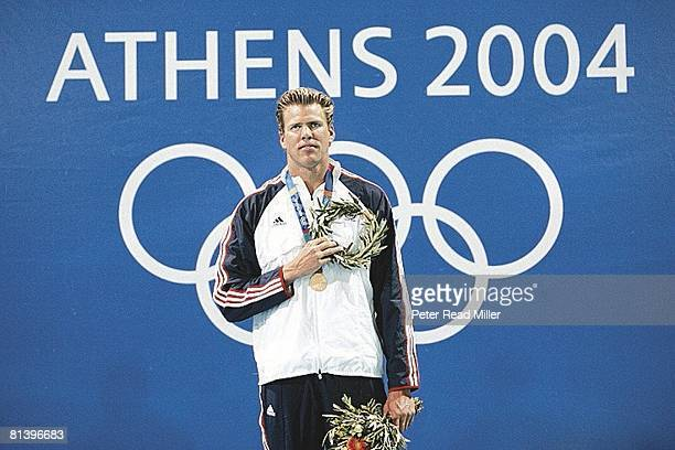 Swimming: 2004 Summer Olympics, USA Gary Hall Jr, victorious with gold medal during National Anthem after winning competition at Olympic Aquatic...