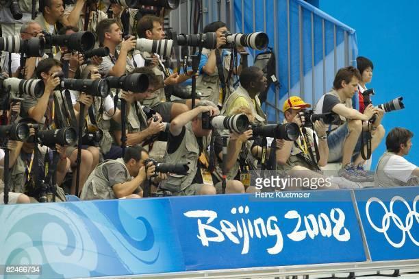 2008 Summer Olympics Photographers during Men's 100m Butterfly Final at National Aquatics Center Beijing China 8/16/2008 CREDIT Heinz Kluetmeier