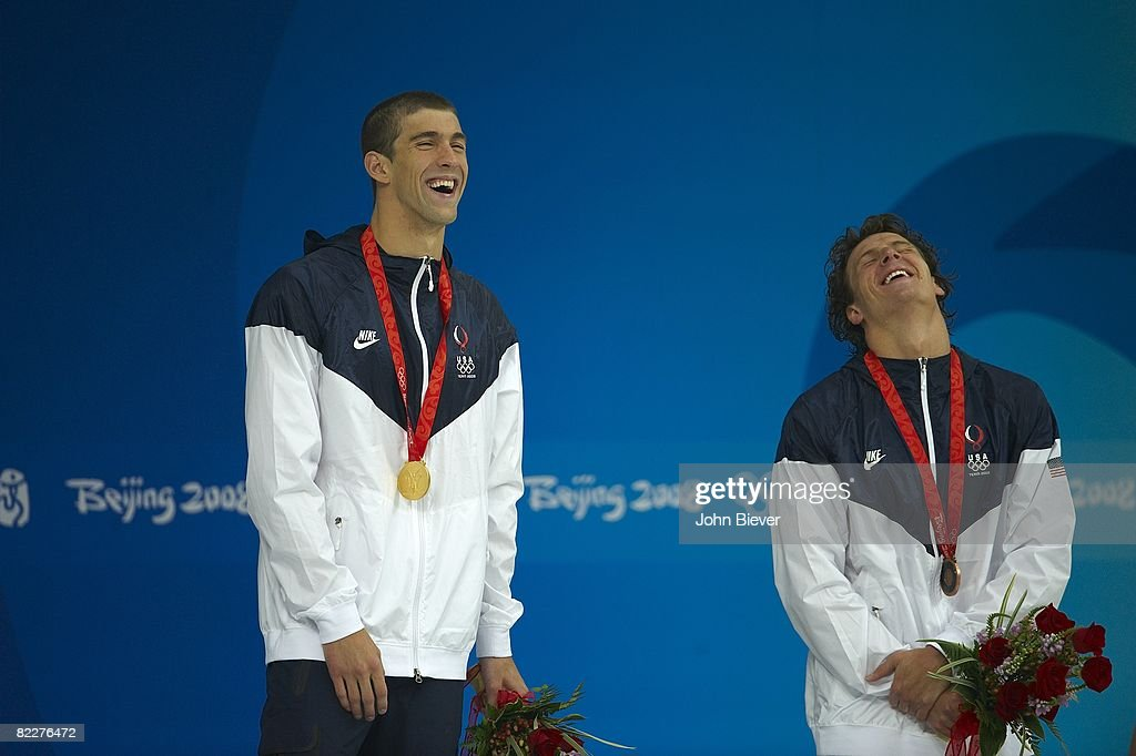 USA Michael Phelps victorious wearing gold medal on medal