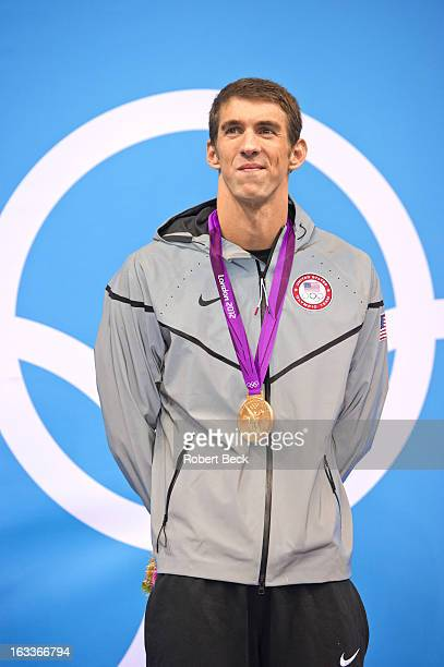 Summer Olympics: USA Michael Phelps victorious on stand after winning Men's 200M Individual Medley Final gold medal at Aquatics Centre. London,...