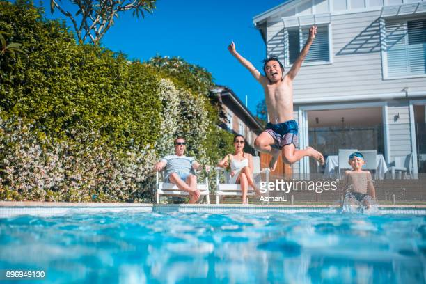swimming and having fun - pool stock pictures, royalty-free photos & images