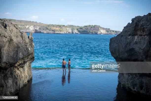 Swimming at Angel's Billabong on Nusa Penida, Indonesia