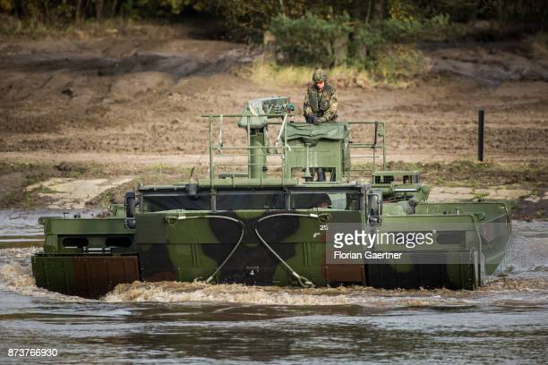 Swimming bridge Amphibie M3 with a soldier. Shot during an exercise of the land forces on October 13, 2017 in Munster, Germany.