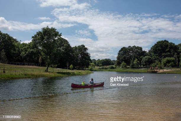 Swimming buoys and areas for boating are set up ahead of the opening of a new wild swimming and recreational lake in Beckenham Place Park on July 11,...