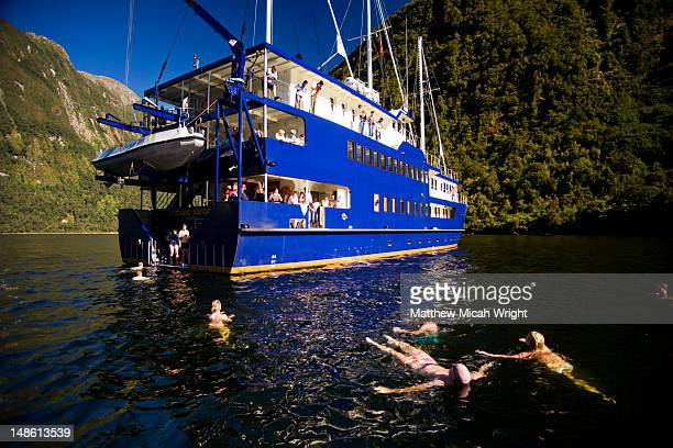 Swimming by cruise boat on Doubtful Sound.
