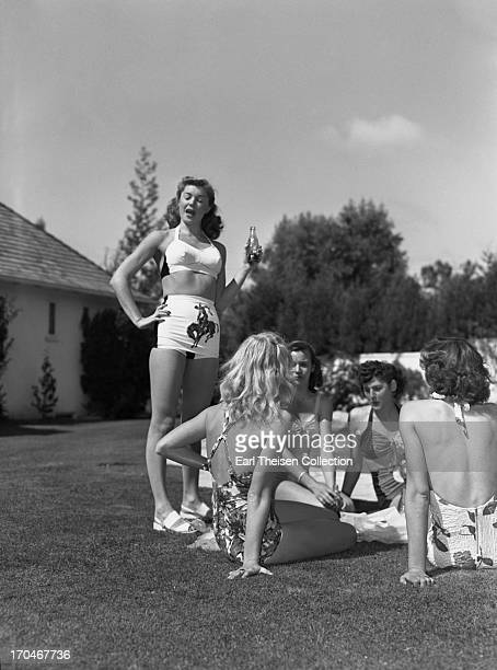 Swimming champion and future movie star Esther Williams enjoys a Coca Cola with her teammates from the Los Angeles Athletic Club at The Beverly Hills...