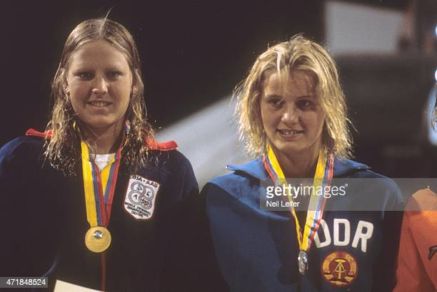 FINA World Championships Closeup of USA Shirley Babashoff and East Germany Kornelia Ender victorious on medal stand after Women's 200M Freestyle...