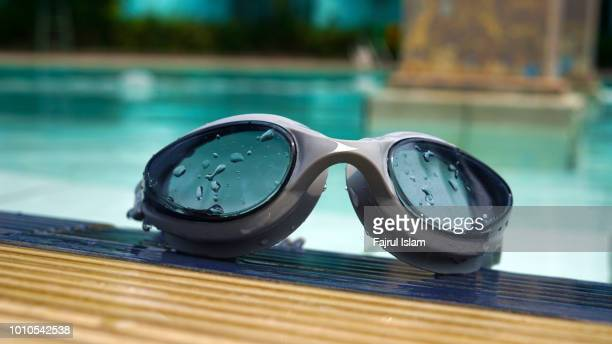 Swimming goggles by the poolside