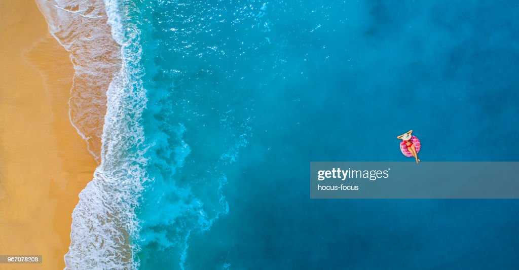 Swimming in clear turquoise sea at summer : Stock Photo