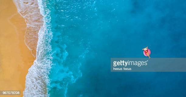 swimming in clear turquoise sea at summer - mediterranean sea stock pictures, royalty-free photos & images