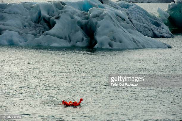 swimming in jökulsárlón glacier lake in iceland - glacier lagoon stock photos and pictures