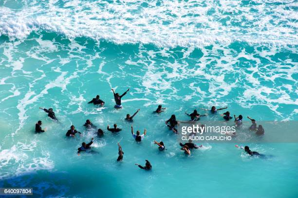 swimming in suit - claudio capucho stock photos and pictures