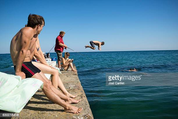 swimming in the black sea in odessa, ukraine - odessa ukraine stock pictures, royalty-free photos & images
