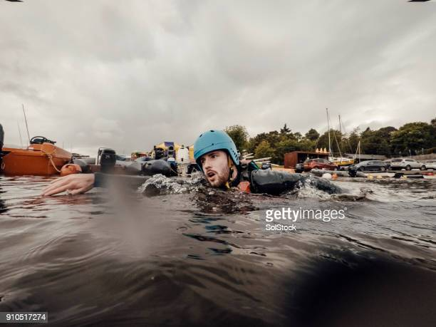 swimming in the lake - keswick stock photos and pictures
