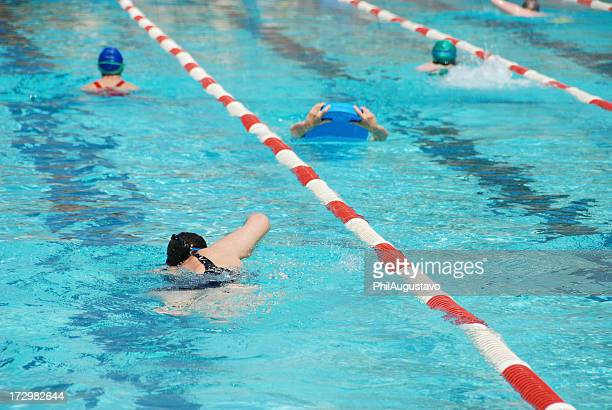 Swimming laps in pool with red and white lane markers