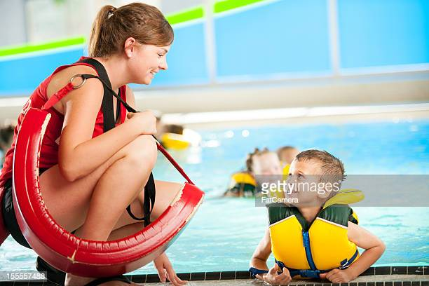 swimming lessons - lifeguard stock pictures, royalty-free photos & images