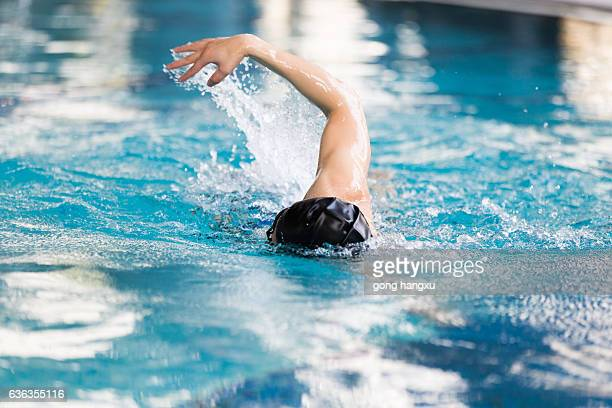 swimming man in swimming pool