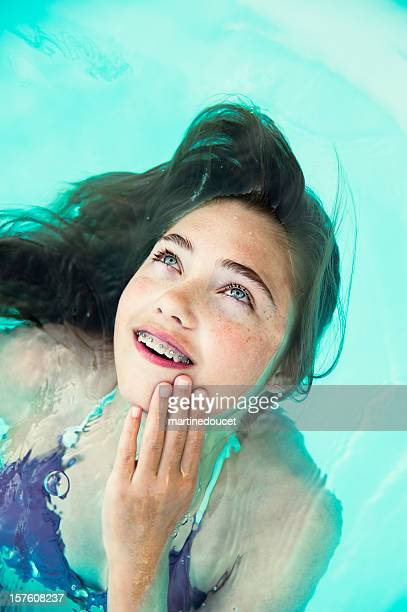 swimming mermaid - beautiful girl smile braces vertical stock photos and pictures